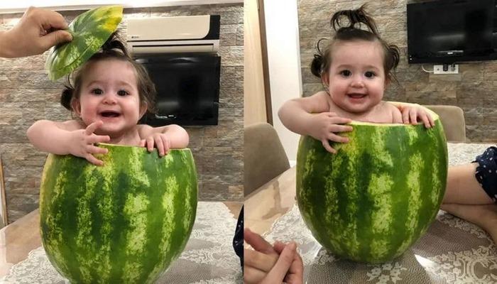 7 aylık bebeğini içini oyduğu karpuzda serinletti