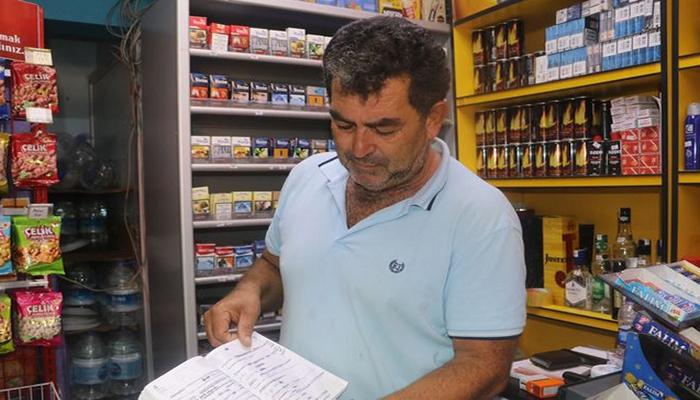 """Türkiyədə adını deməyən şəxs marketin """"nisyə dəftəri""""ni satın aldı"""