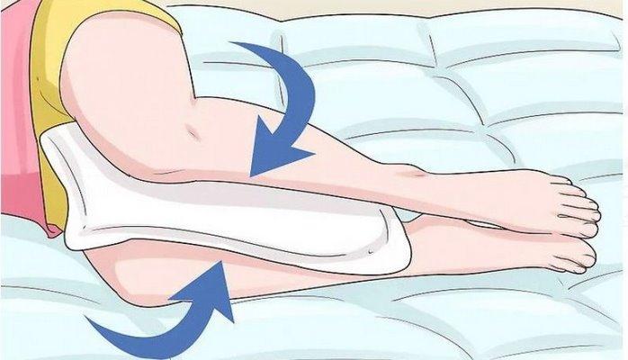 Yatanda ayaqların arasına yastıq qoyun - 5 inanılmaz faydası